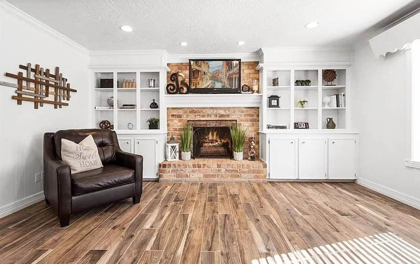 Living room with white built in bookshelves and decor