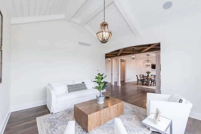 Living room with white shiplap ceiling
