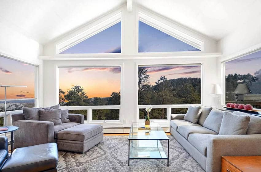 Living room with white vaulted ceiling