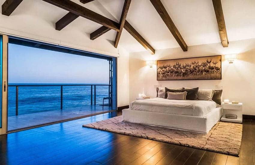 Luxury bedroom with wood vaulted ceiling ocean views