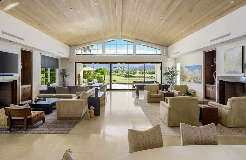 Luxury living room with vaulted ceiling sliding glass doors