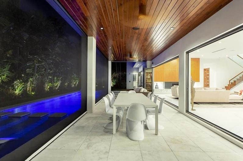 Modern enclosed pool patio with sliding doors glass windows dining table