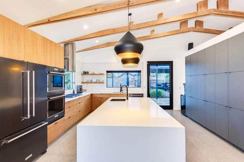 Modern kitchen with wood vaulted ceiling