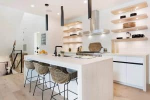 Staged kitchen design with open shelving white cabinets