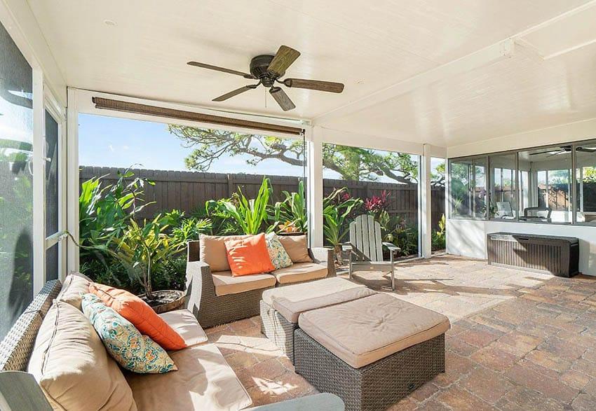 Sunroom patio enclosure with paver flooring
