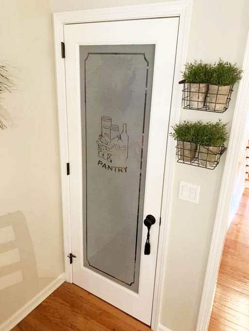 White pantry door with frosted glass window