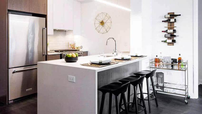 Contemporary kitchen with stainless steel refrigerator and home bar cart
