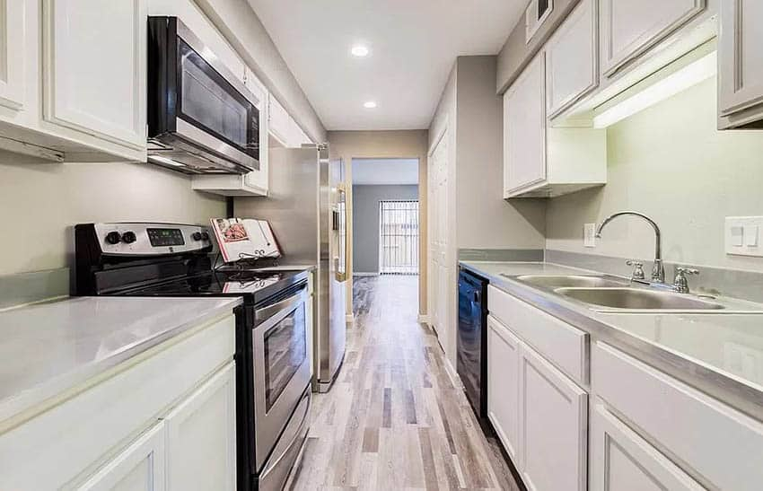 Galley kitchen with faux concrete countertop