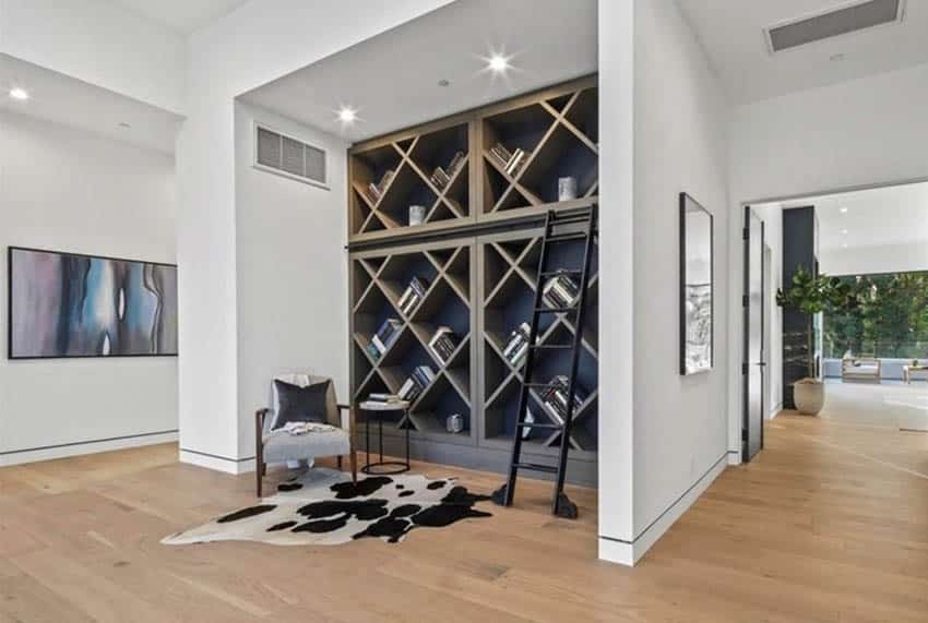 Home office with geometric built in bookshelves library