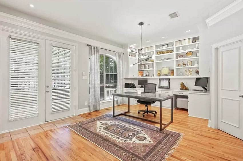 Home office with white built in cabinets and shelves