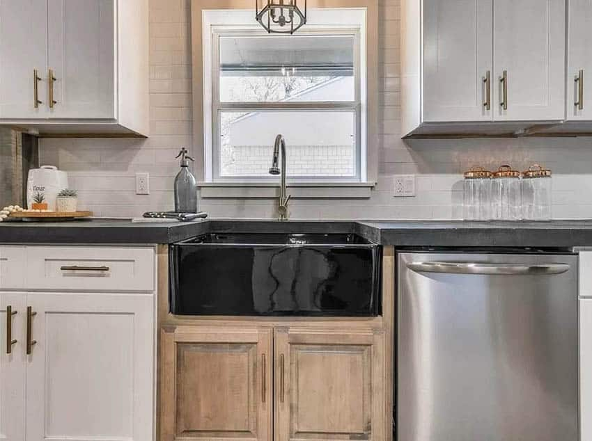 Kitchen with black concrete countertops