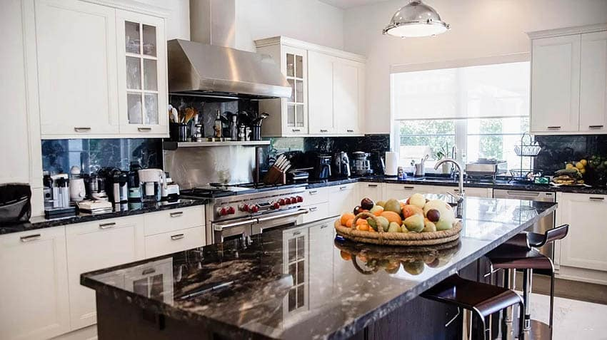 Kitchen with black onyx countertops white cabinets