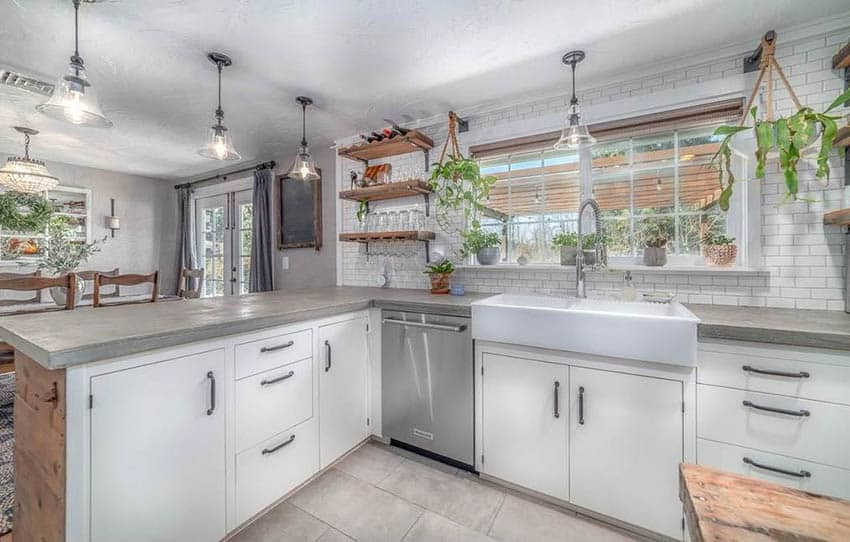 Kitchen with concrete overlay countertops and white cabinets