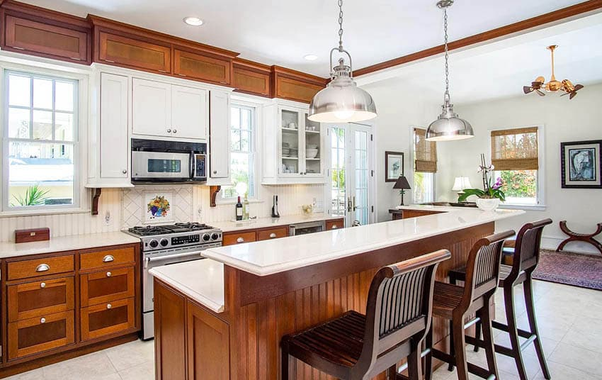 Kitchen with limestone countertops and breakfast bar island