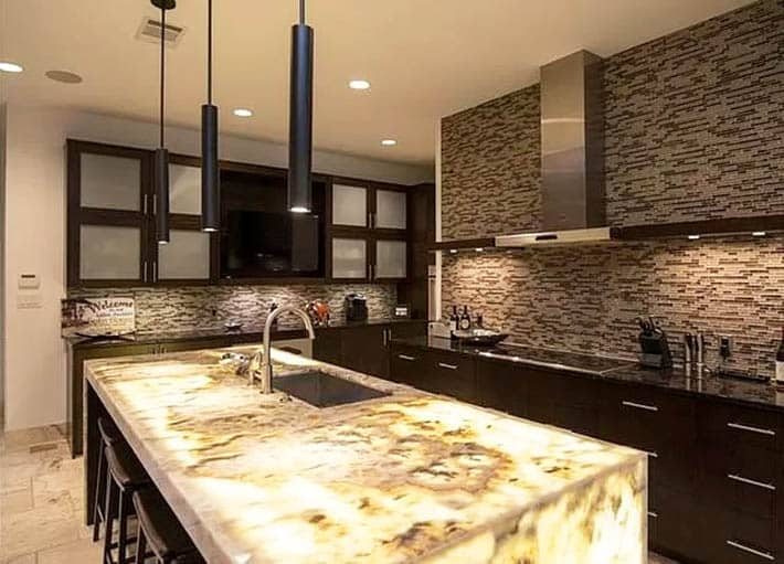 Kitchen with onyx countertops with lights