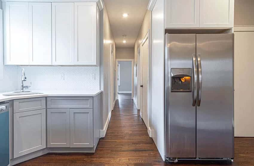 Kitchen with side by side refrigerator