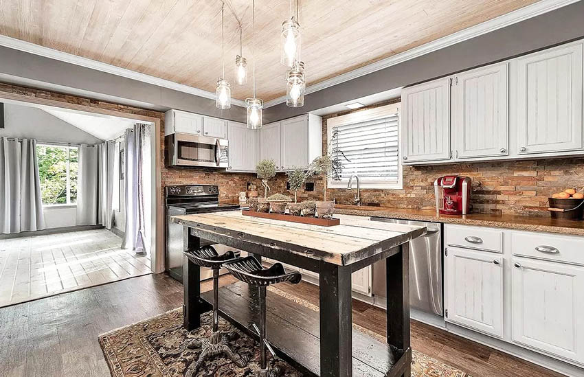 Kitchen with stained concrete countertops rustic wood island and white cabinets