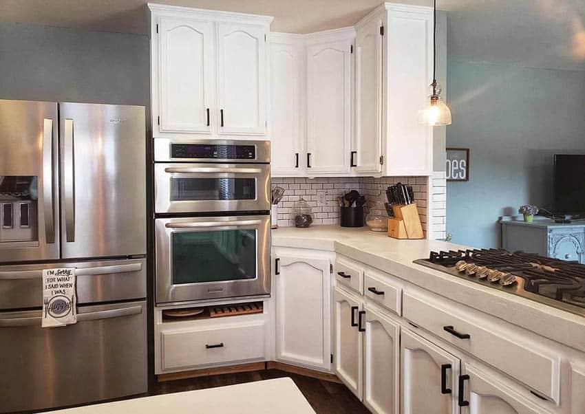 Kitchen with white concrete countertop and white cabinets