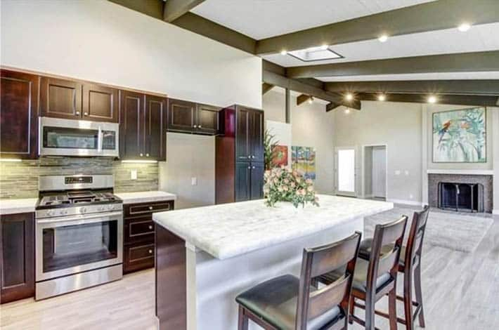 Kitchen with white onyx countertops cherry cabinets