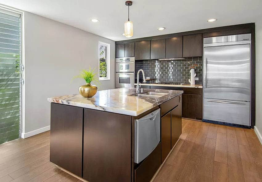 Modern kitchen with dark wood cabinets and onyx countertops