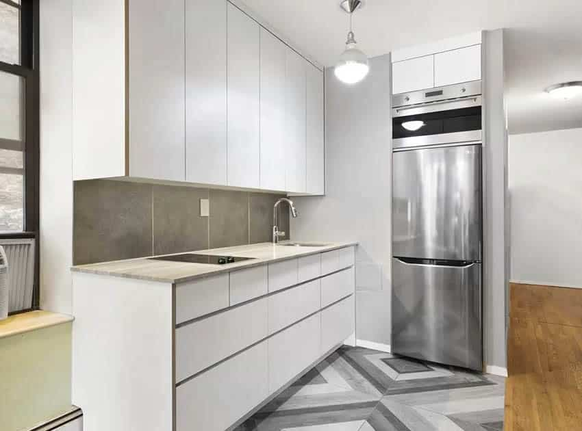 Small modern kitchen with chennille limestone countertop white cabinets