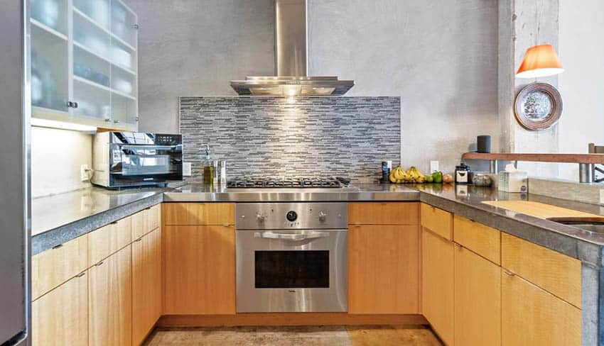 U shaped kitchen with thick concrete overlay countertops