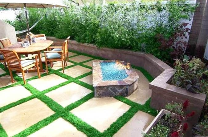 Artificial grass concrete patio steps with fire pit
