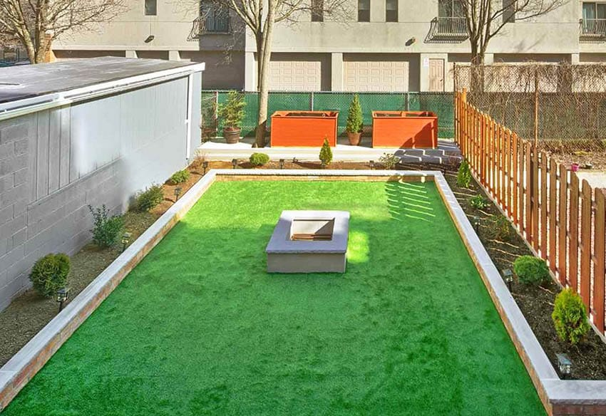 Artificial grass patio with fire pit