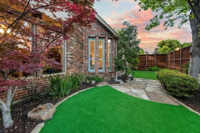 Backyard landscaping with artificial grass