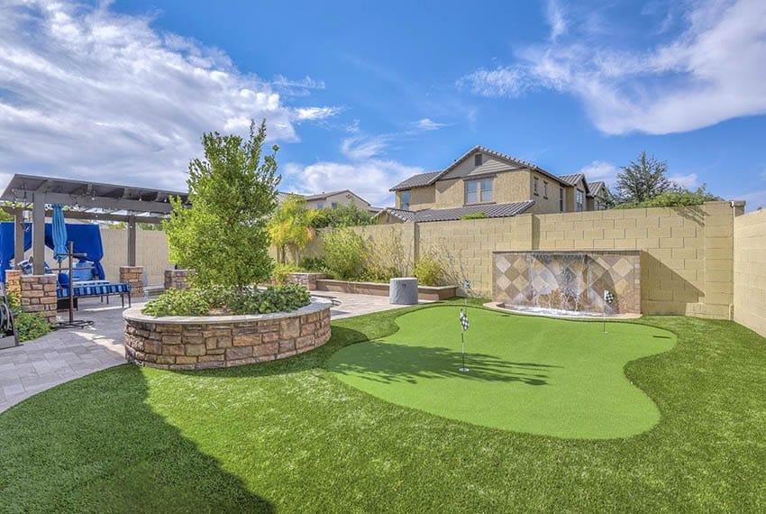 Backyard putting green with artificial grass