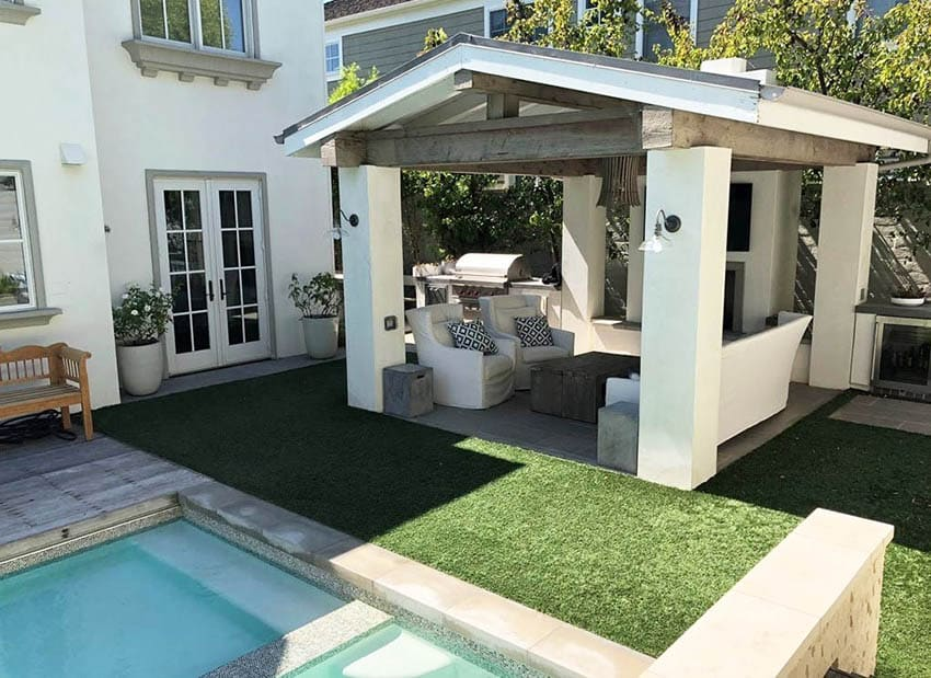 Backyard with pool cabana and artificial grass
