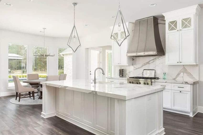 Beautiful kitchen with high gloss porcelain countertops and white cabinets
