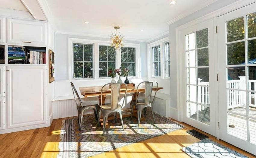 Bright breakfast nook with built in bench and wood dining table