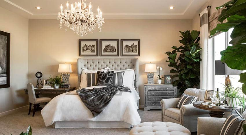 Contemporary bedroom design with sitting area and chandelier