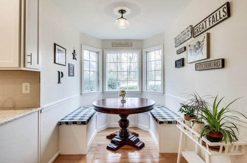 Dining room with built in breakfast nook bench picture windows