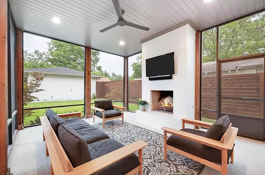 Enclosed patio with fireplace, tv and ceiling fan