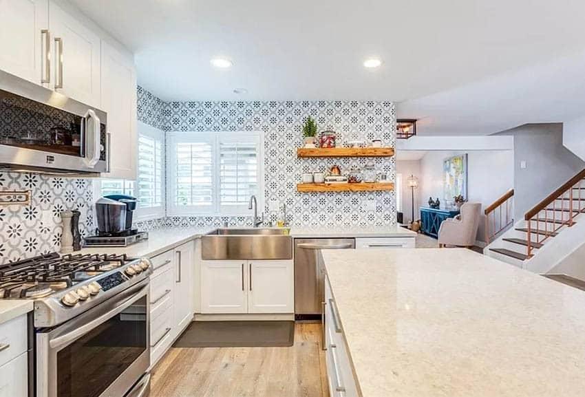 Kitchen with corner windows plantation shutters, tile wall backsplash and open shelves