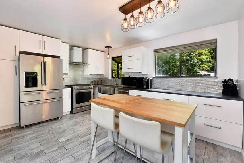 Kitchen with garden window above sink white cabinets