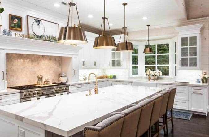 Kitchen with Neolith porcelain countertops and white cabinets