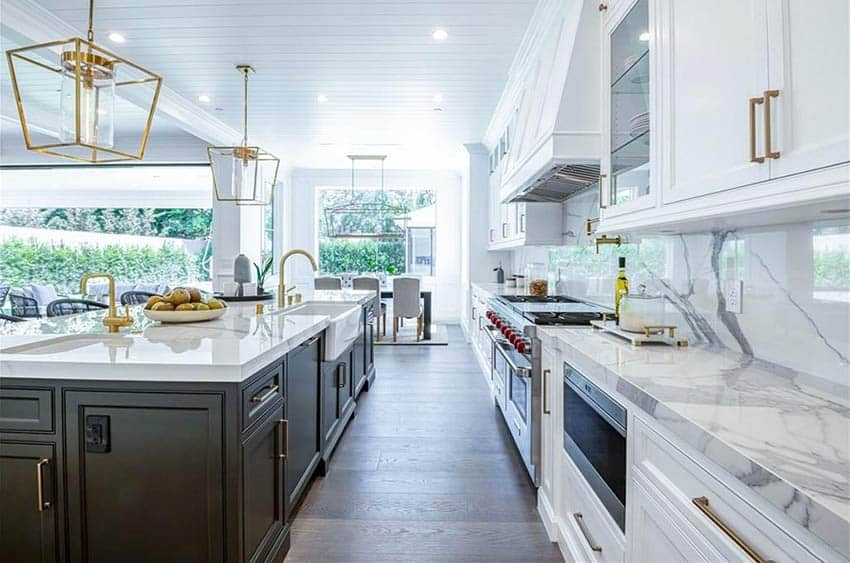Kitchen with porcelain countertops white cabinets and dark brown island