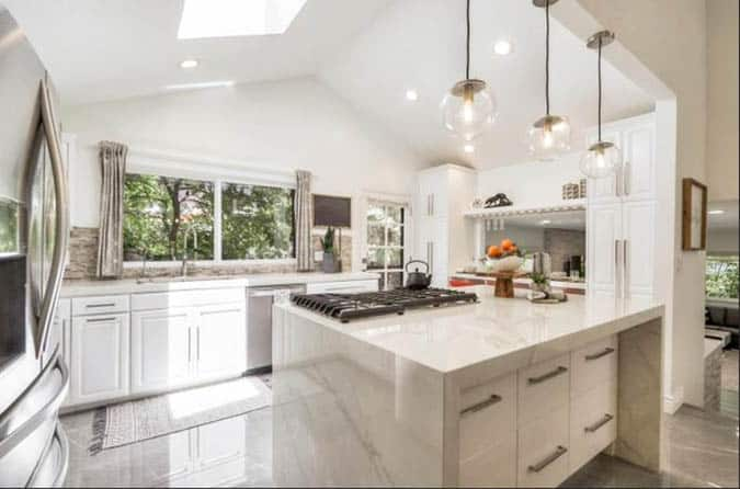 Kitchen with white porcelain countertops white cabinets