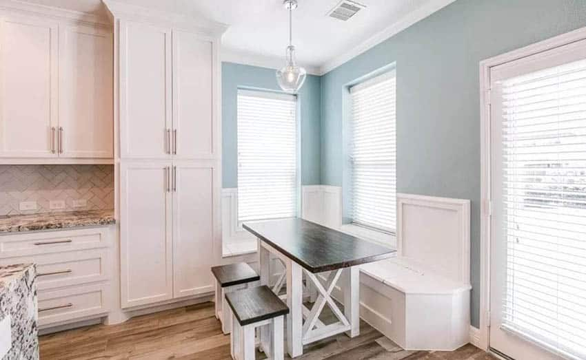 Kitchen with white shaker style built in breakfast nook