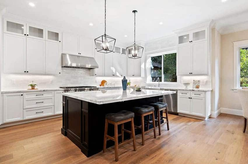 L shaped kitchen with white cabinets porcelain countertops white tile backsplash