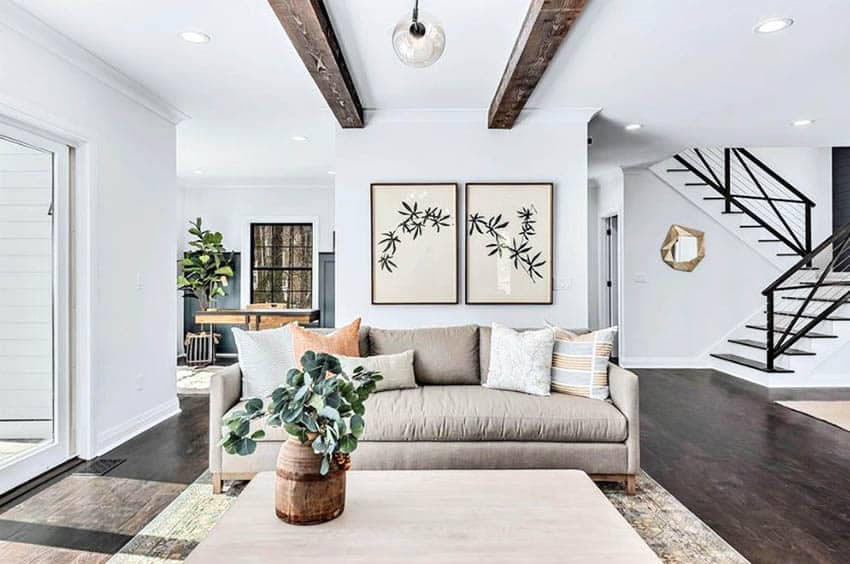 Living room with sofa and faux wood beams on ceiling