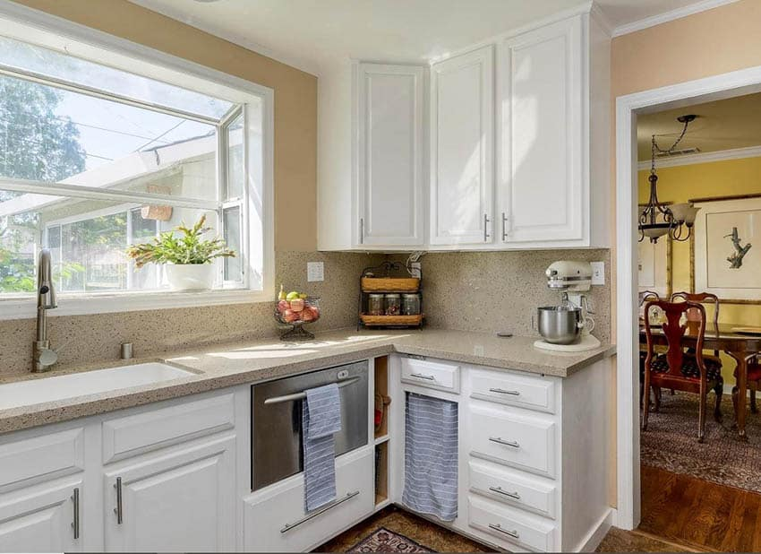 Traditional kitchen with garden window and potted plant