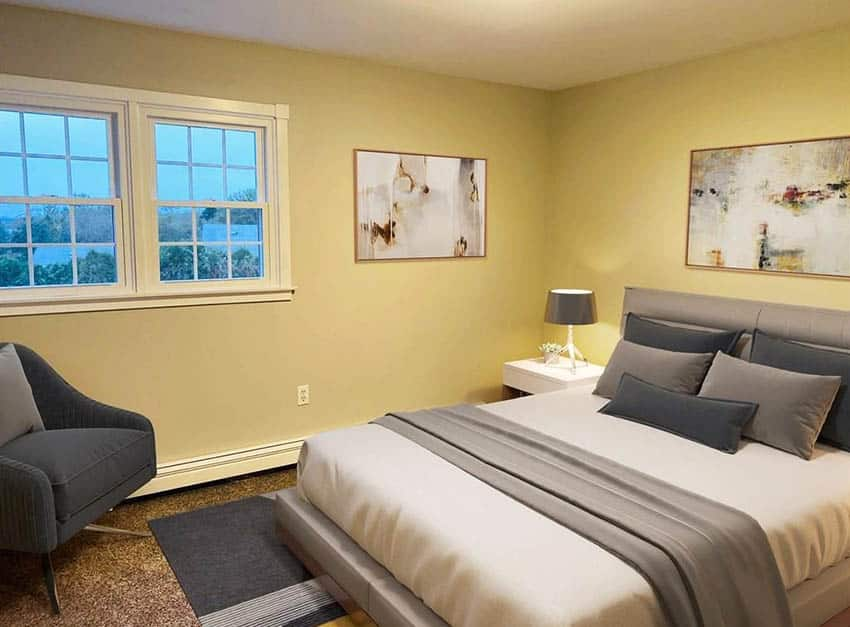 Bedroom with yellow paint and gray decor