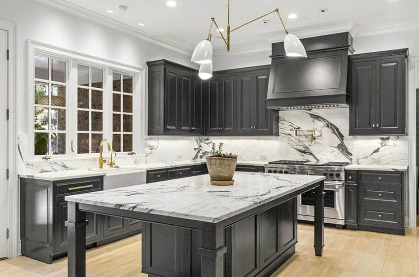 Contemporary black and white kitchen design with black cabinets and white quartz countertops