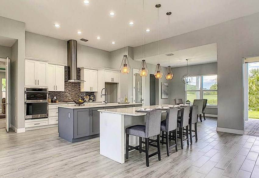 Contemporary kitchen with double islands with gray and white cabinets