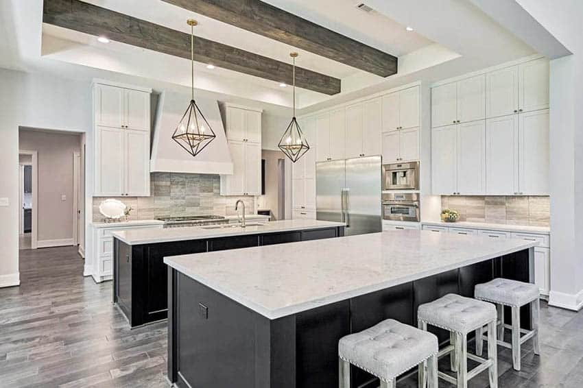 Contemporary kitchen with two black cabinet islands white main cabinets wood beams