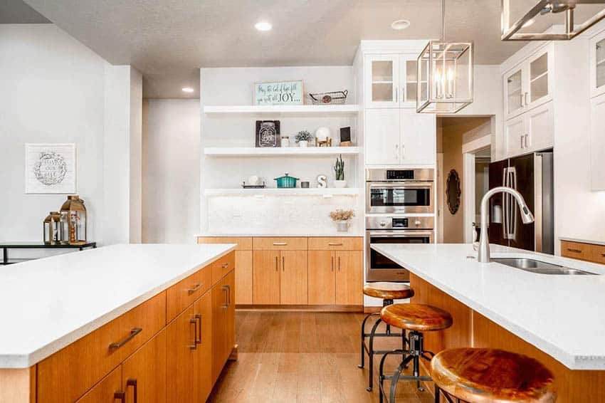 Contemporary kitchen with two islands and white quartz countertops